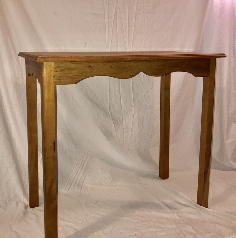 WPI woodworking hobbyist makes a table to use for online zoom classes