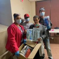 Worcester Stitchers: Net of Compassion Staff Receiving a Mask Delivery
